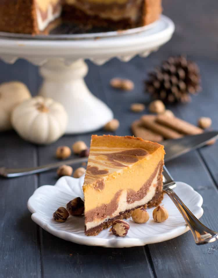 Triple Layer Pumpkin Nutella Cheesecake. Three flavors of cheesecake, a bonus layer of pure Nutella on the bottom, on a hazelnut speculoos cookie crust!