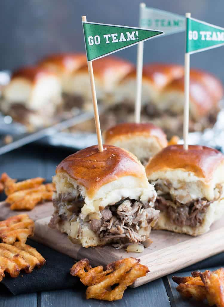 Philly Cheesesteak Sliders. Tender shaved steak, fried onions and mushrooms, melty cheese and a buttery toasted bun make these sliders a delicious choice for game day. Free printable pennants make them fun!
