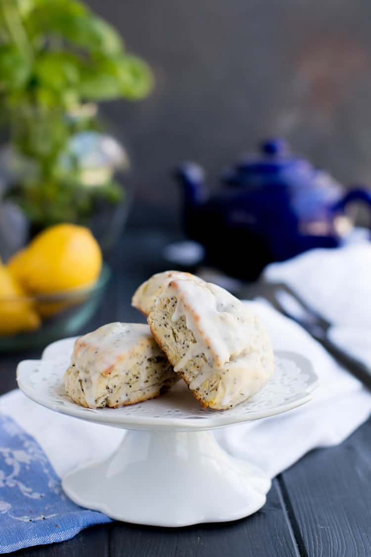 Lemon Ricotta Poppy Seed Scones are rich with butter and ricotta cheese, speckled with poppy seeds and covered in a super lemony glaze.