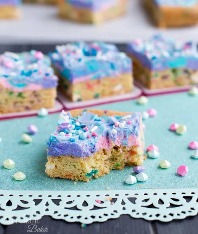Mermaid Birthday Sugar Cookie Bars. Birthday cake flavored sugar cookie bars, topped with colorful swirls of frosting and festive sprinkles.