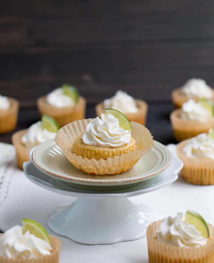 Easy Mini Key Lime Pies come together quickly with just five ingredients and one bowl. Creamy and full of fresh lime flavor, a perfect dessert for summer!