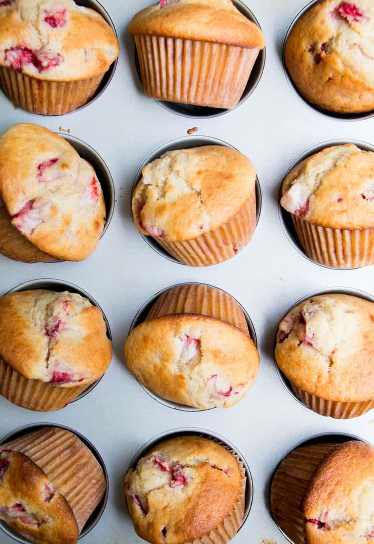 Fresh Strawberry Muffins titled out of cupcake tin to cool from themerchantbaker.com