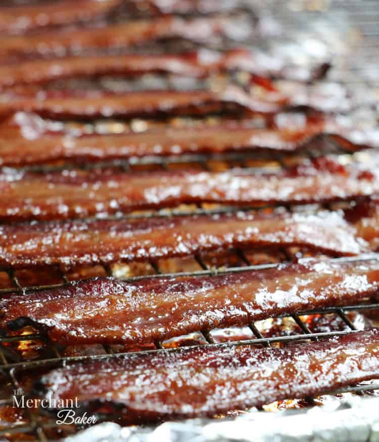 Brown Sugar Maple Glazed Bacon fully cooked on a baking dish from themerchantbaker.com