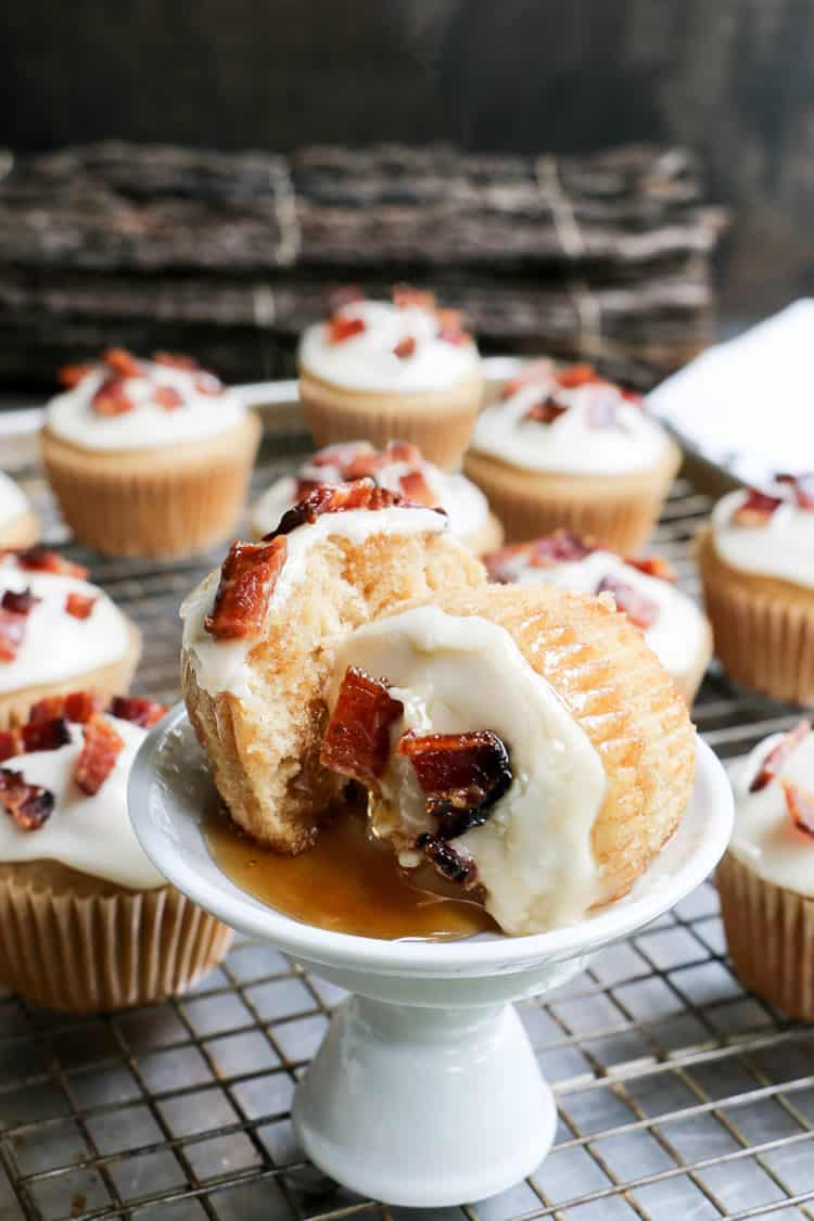 Glazed Bacon Maple Syrup Muffins, made with pure maple syrup and butter, topped with glazed bacon. Perfect sweet and savory treat for breakfast or brunch!