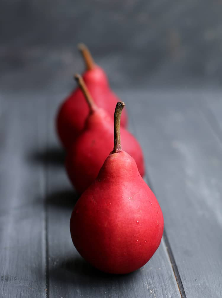 three red pears in a vertical row