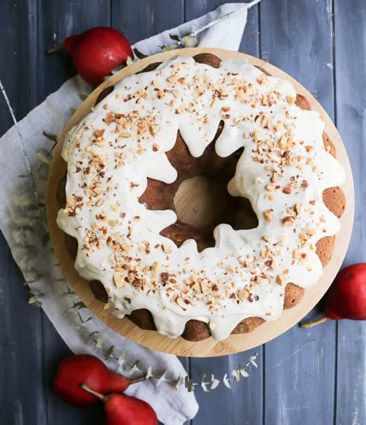 Chai Spiced Pear Bundt Cake is filled with fresh ripe pears and gently spiced with cinnamon, cardamom and cloves. A spiced icing is accented with chai tea.