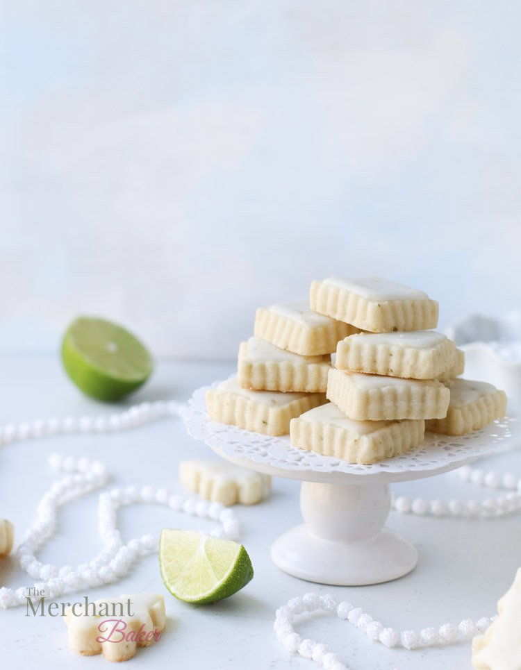 Stack of lime meltaway cookies sitting on a small cake stand.