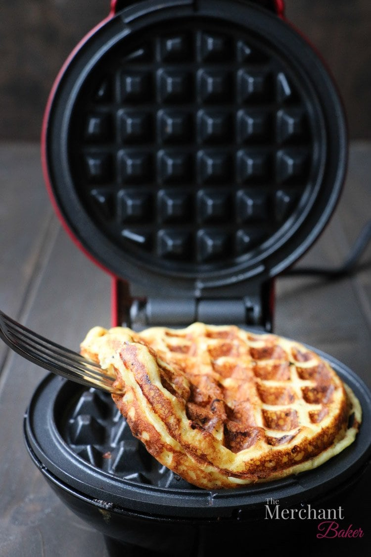 A fork removing a chaffle from a waffle iron
