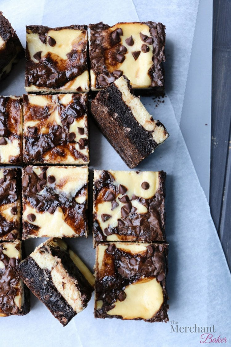 Pan sized Irish Cream Cheesecake Brownies cut into smaller squares by themerchantbaker.com
