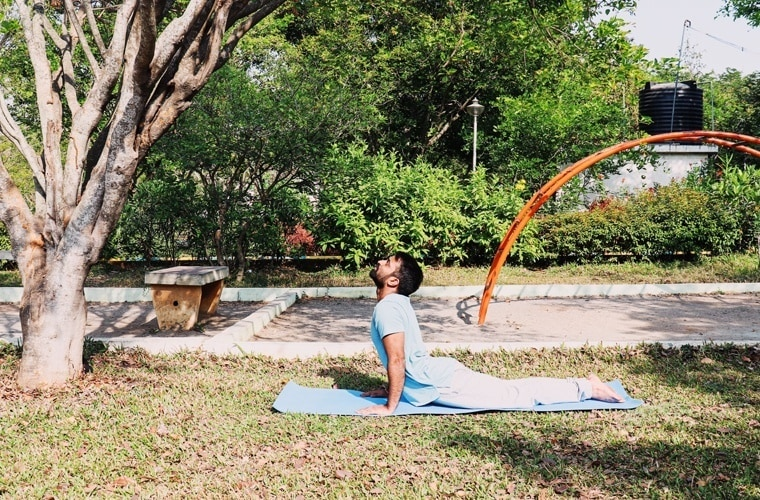 The correct neck position in Bhujangasana is the one where you neck is in the curvature line of your back.