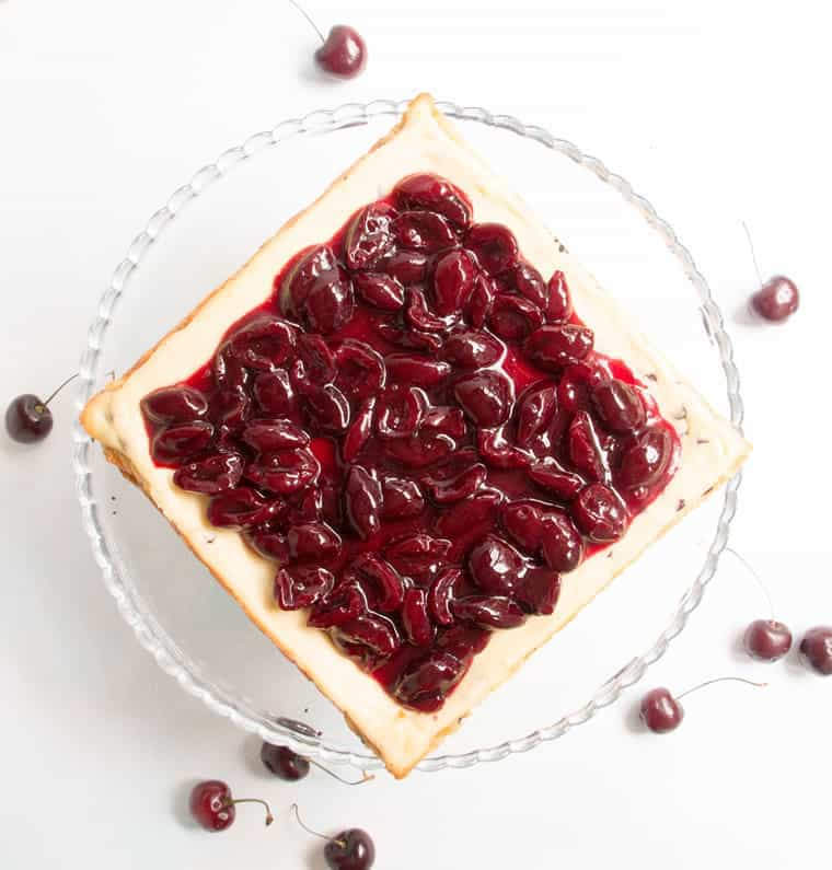Chocolate Chip Cherry Cheesecake. A fresh sweet cherry sauce tops this easy to make cheesecake. A super fudgy cookie crust takes it over the top!
