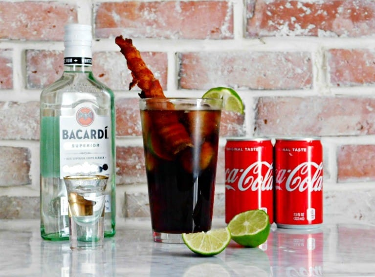 rum and coke with a bacon straw