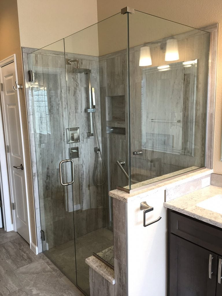 Exterior view of shower with glass walls in remodel of bathroom in Lakewood