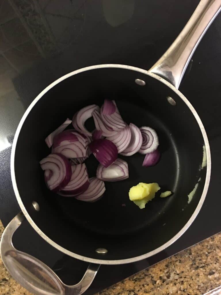 stock pot with ghee and chopped onions