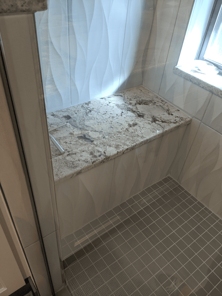 Littleton bath remodel granite shower seat