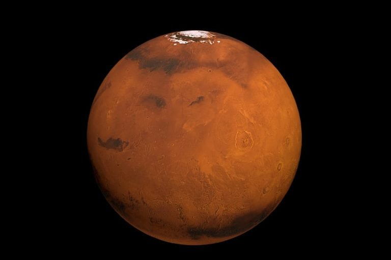 Mars with white polar cap shown