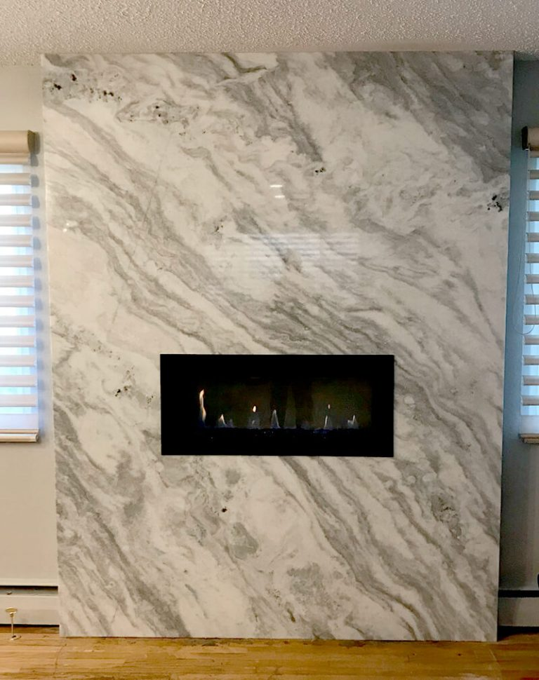 Quartz fireplace wall in remodel of living room in Golden