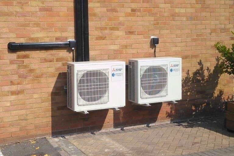 Mitsubishi electric 2 domestic external air conditioning units with neat black trunking