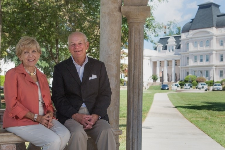 Cathy and Pete Miller pose for a portrait on the front lawn of Brenau's Historic Gainesville Campus. (AJ Reynolds/Brenau University)