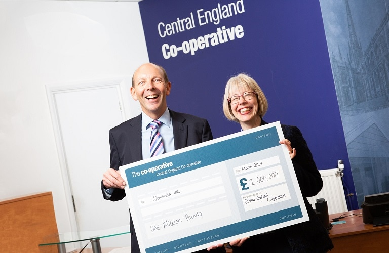 Hilda and Martyn holding the Co-operative cheque