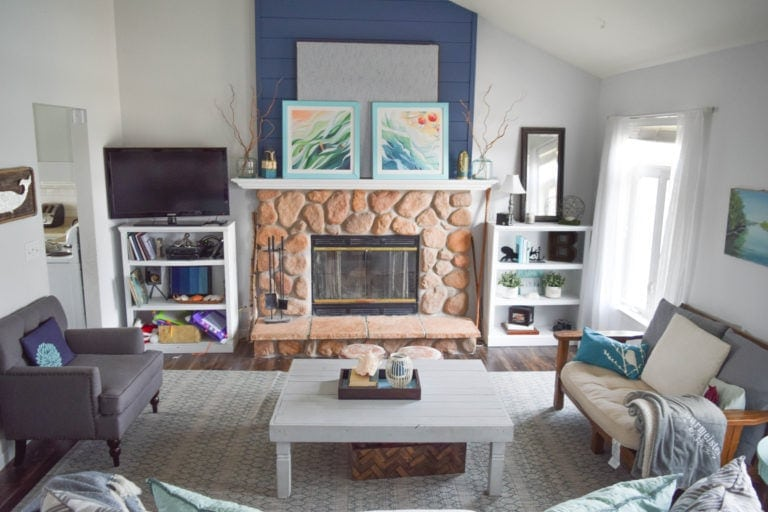 Fireplace with stone and blue shiplap
