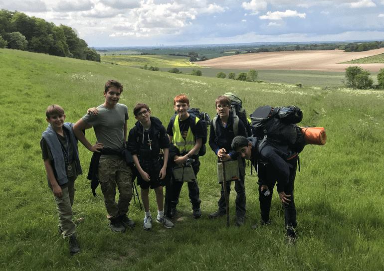 Six Leighton Park pupils take a break in field as part of their Bronze Duke of Edinburgh