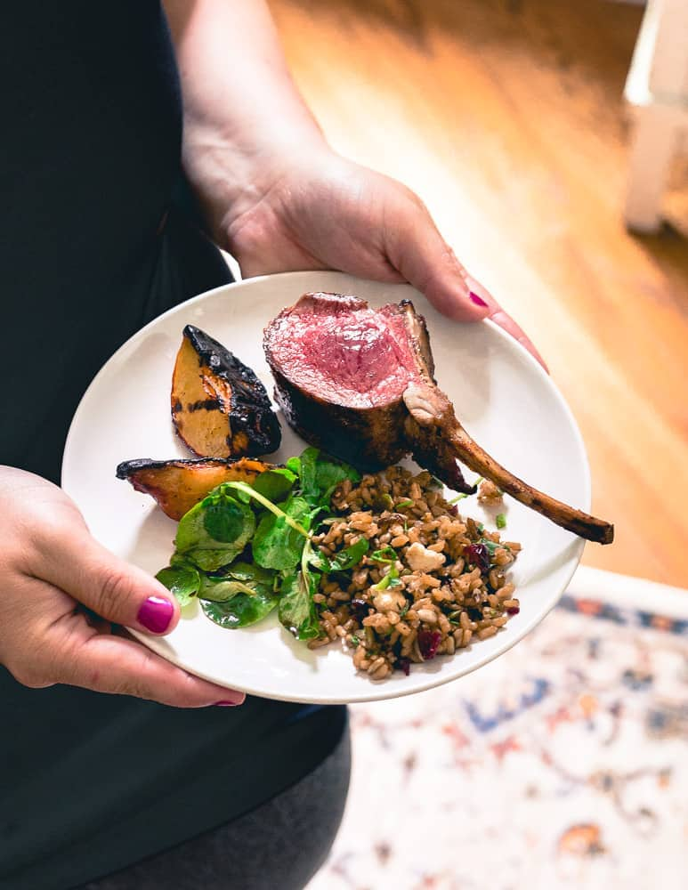 A simple summer meal of grilled lamb chops, grilled peaches, wild rice salad and watercress will impress any guest.