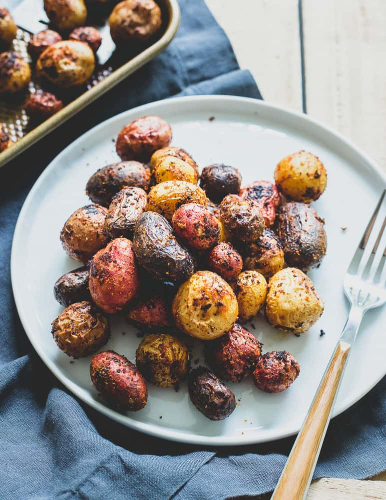 Peri Peri potatoes are roasted to perfection and coated in a deliciously aromatic Portuguese spice mixture that makes a great side dish to any dinner.