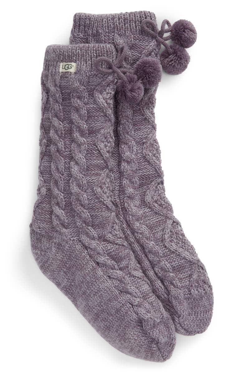 The UGG pompom socks will keep you warm and cozy