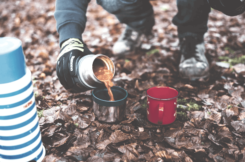 canned camping food poured into a cup