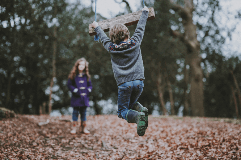 children playing in the woods