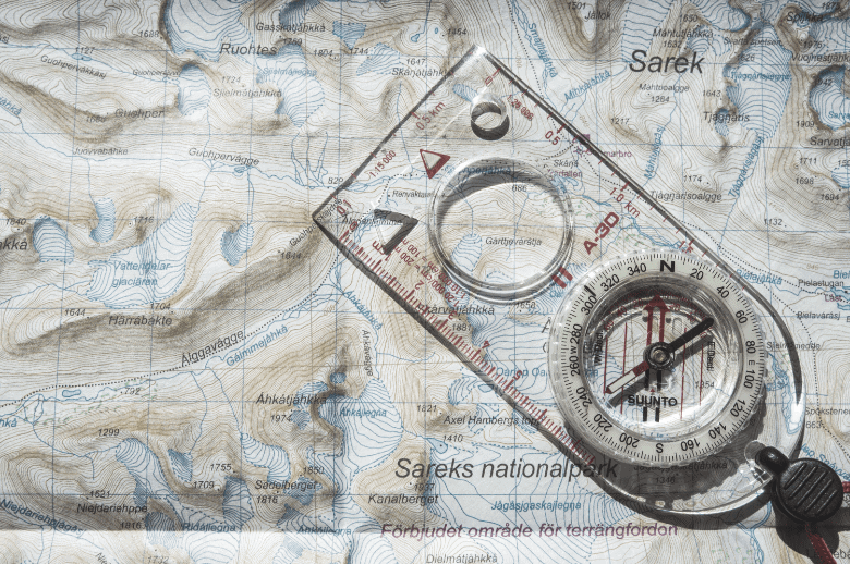 compass with a baseplate on a map