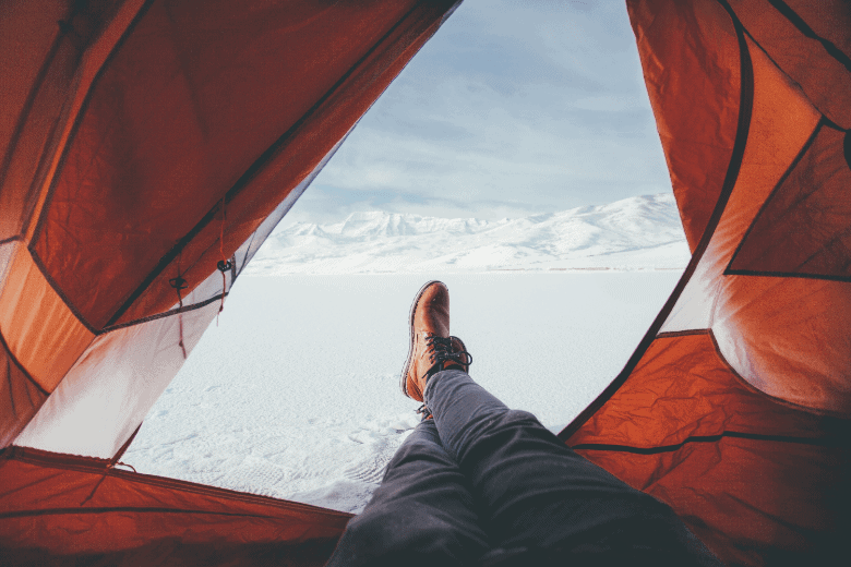 person in cold weather in a tent