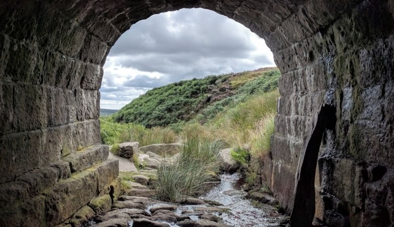 Spiritual victory: Sea coast visible through a tunnel representing the ed of a journey