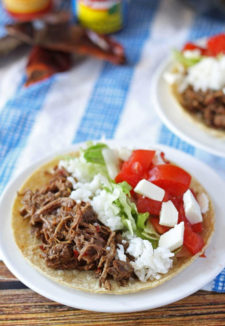 slow cooker barbacoa beef in a taco