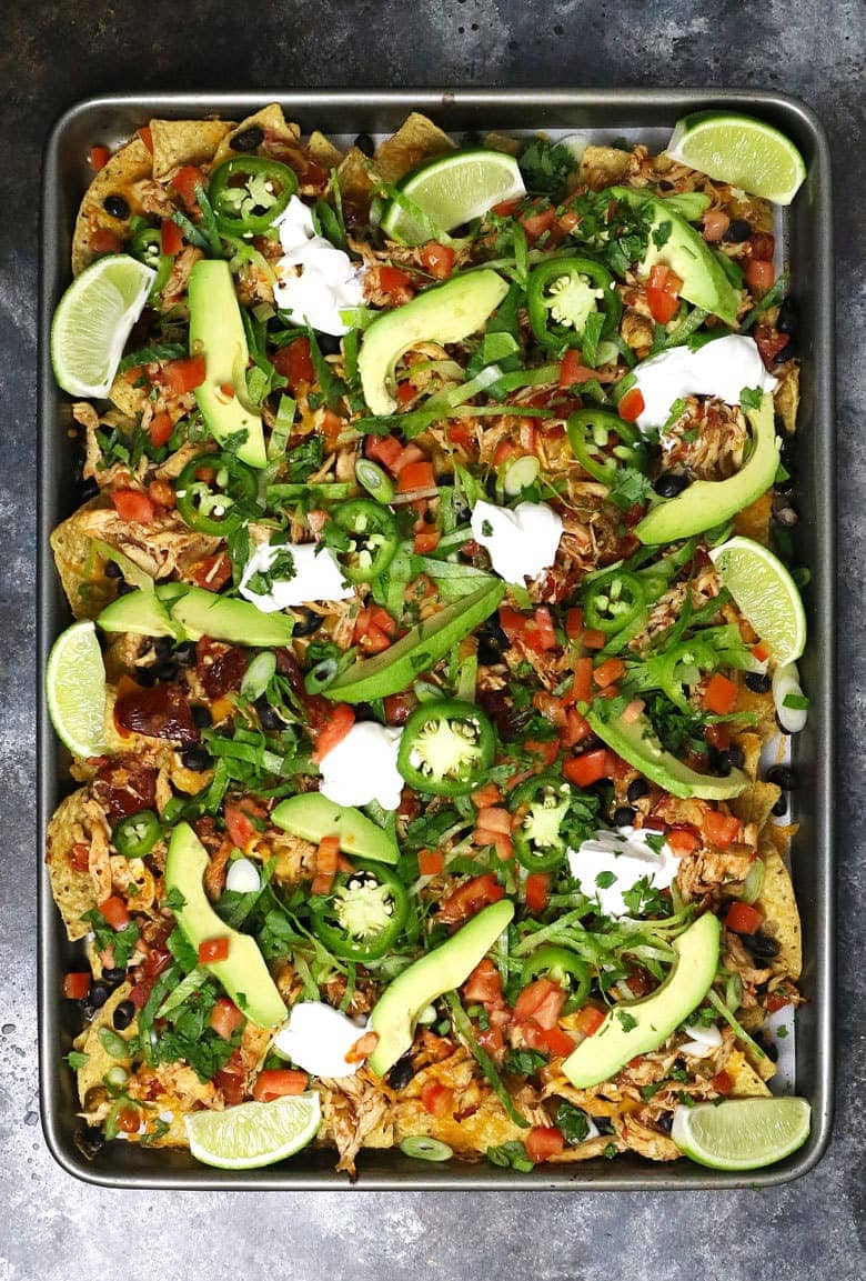 overhead picture of loaded sheet pan chicken nachos