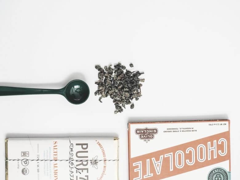 green spoon with loose leaf tea