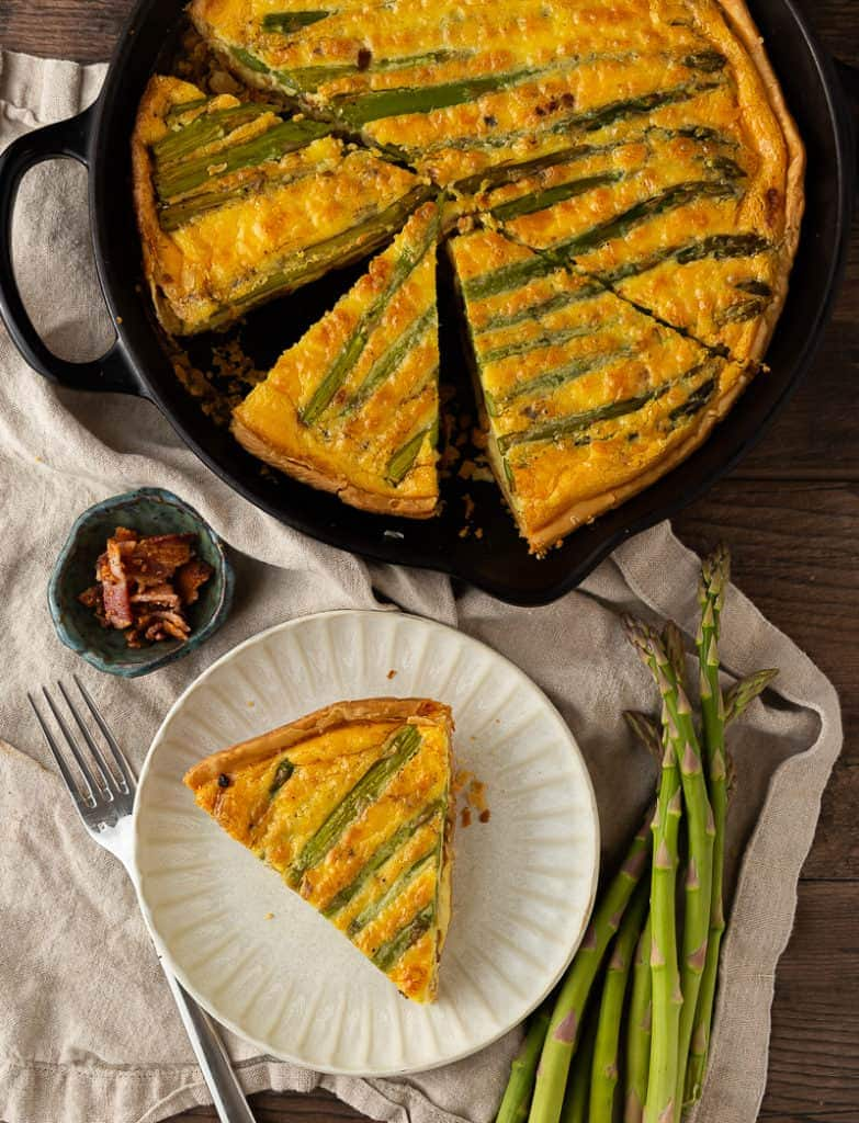 Slice of asparagus and bacon quiche