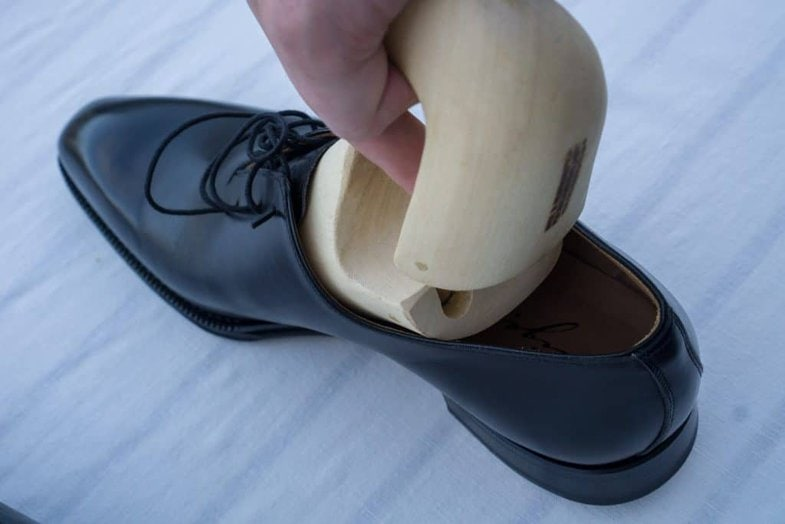 The problem is that the shoe tree is formed after the shape of the foot which is widest at the ball area, which must get through the slimmer instep of the shoe, which can be a bit tricky and often the shoe is stressed quite a bit here. When one insert the trees you often do it in the same way, creating the same problem again.
