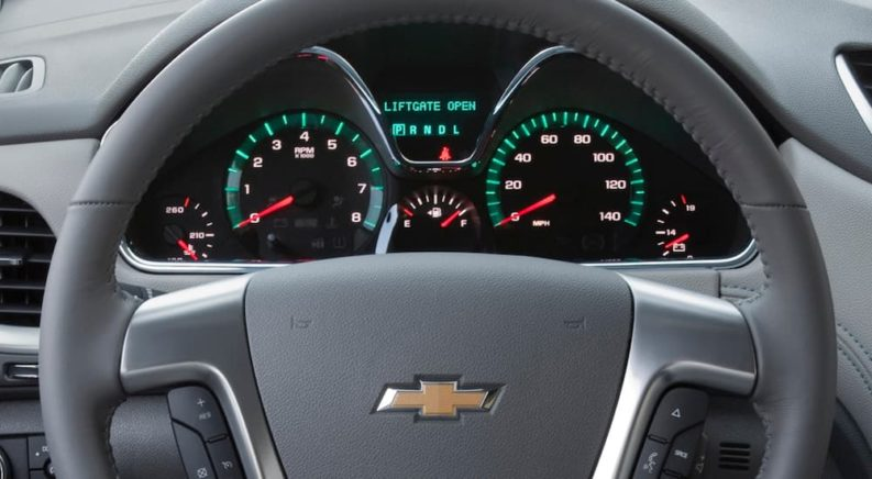 The dashboard of a 2013 Chevy Traverse, which would display any Chevy check engine lights, is shown.