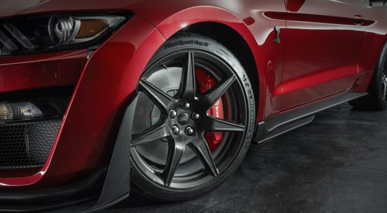 The wheels on a red 2020 Ford Mustang GT500 are shown.