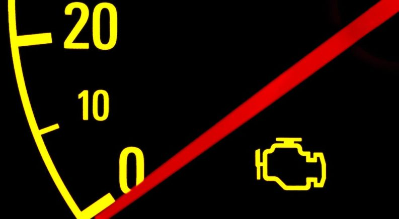 A speedometer and check engine light is shown.