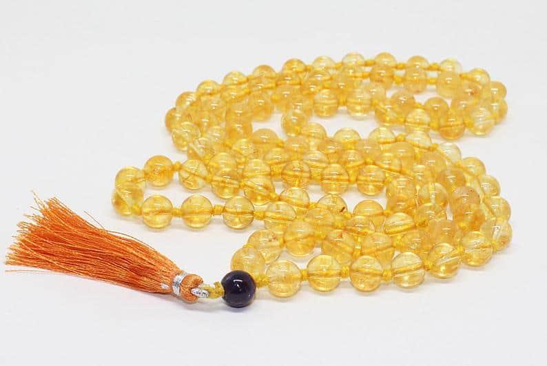 yellow mala beads