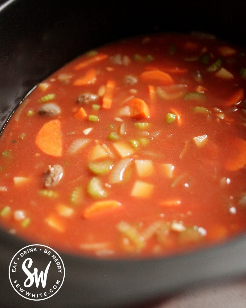 Slow cooker cooking the venison sausages