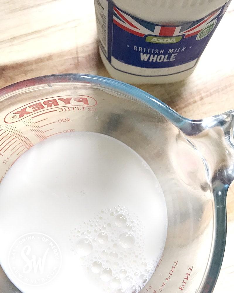 how to make Hot Cross Bun Dessert - cream in a jug