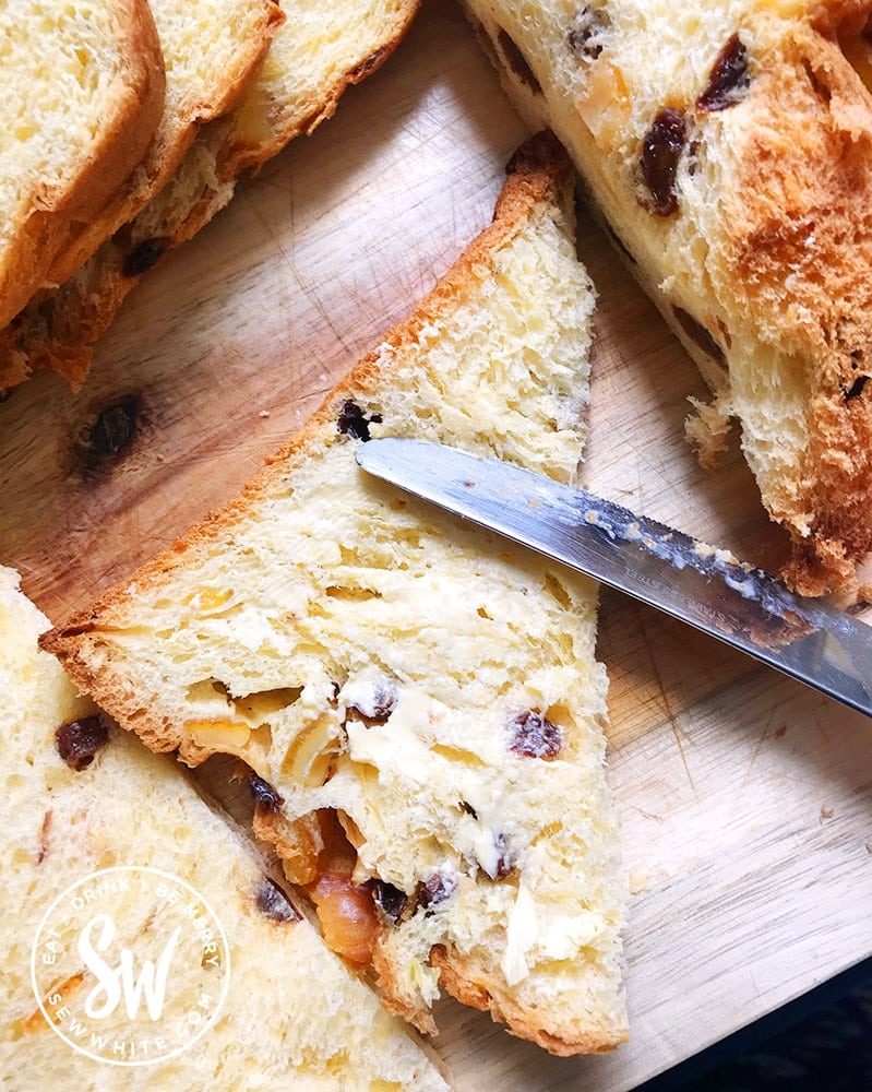 Buttering the panettone for the Panettone Bread and Butter Pudding