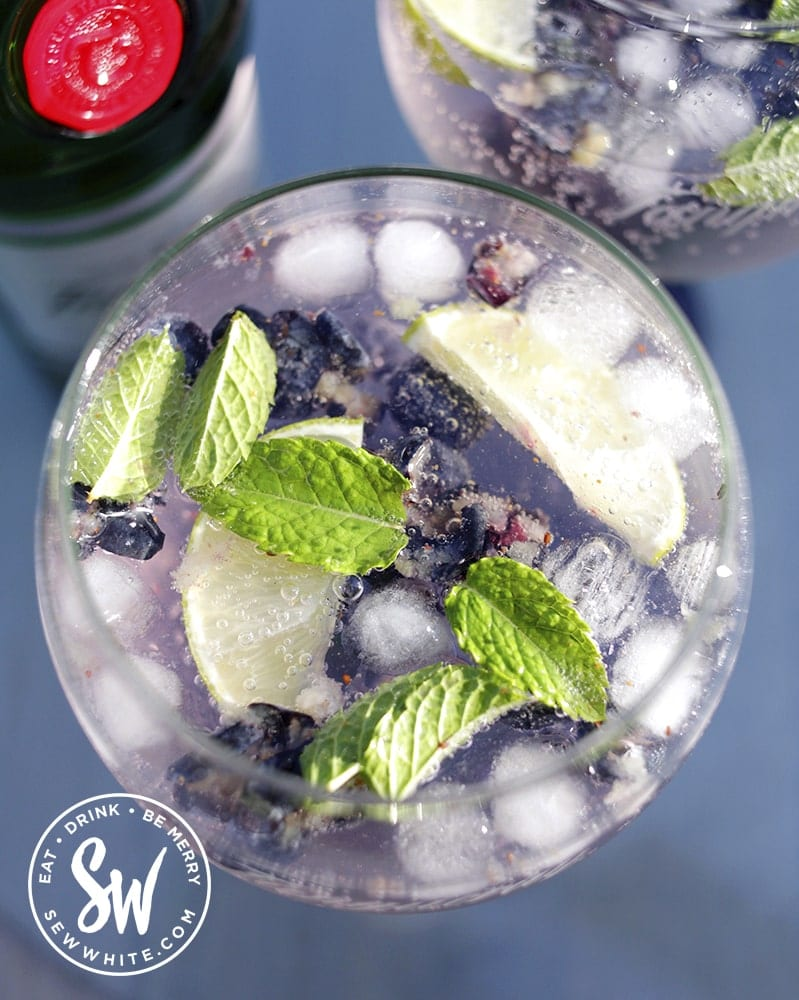 a top view of the blueberries, mint and lime for the  Blueberry Gin and Tonic Recipe
