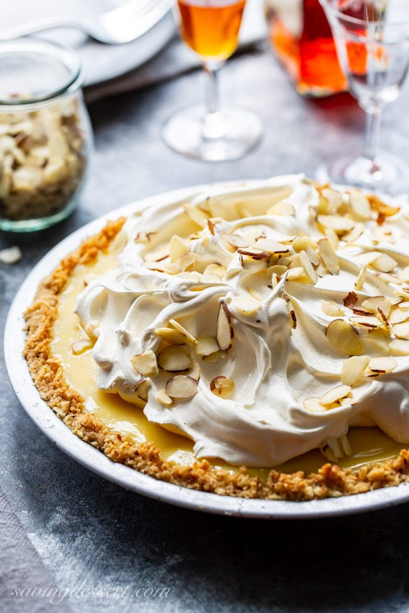 An Amaretto Cream Pie topped with whipped cream and sliced almonds