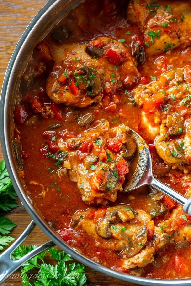 A large skillet filled with Chicken Cacciatore with peppers, onions and mushrooms