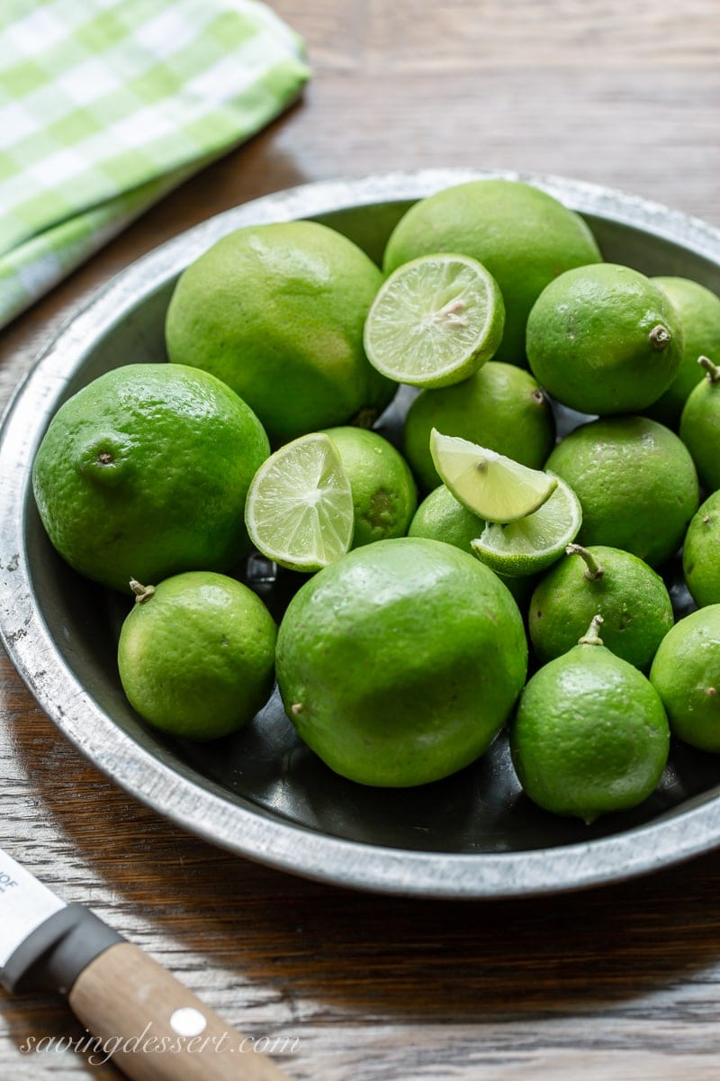 A pan filled with Persian and Key Limes